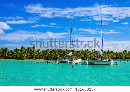 Catamarans on azure water Caribbean holidays Sanoa Dominican Republic