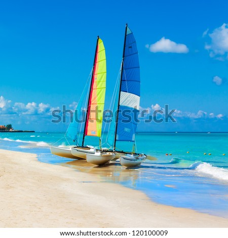 Catamarans with their colorful sails spread out on Varadero beach in Cuba