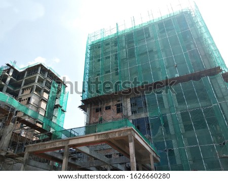 Catch platform and safety netting at the exterior of the building during high-rise building construction. It protects individuals and property from falling debris.
