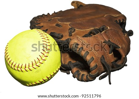 Catcher's glove with loose yellow softball isolated on white background