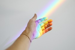 Catching a rainbow in your hand.