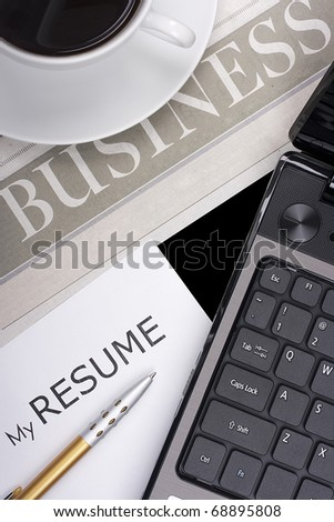 Category newspaper about the business with items related to job search: resume, laptop, etc.