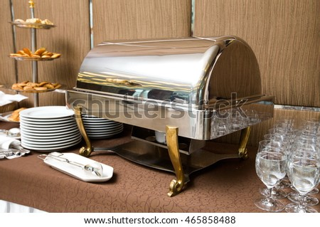 Catering at event - buffet dish warming metal tray in luxury style.