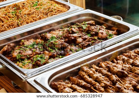 Catering Buffet Food Dish with Meat and Colorful vegetables on a Table ストックフォト ©