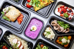 Catering food with healthy balanced diet delicious lunch box boxed take away deliver packed ready  meal in black container dinner, meal, brakfast