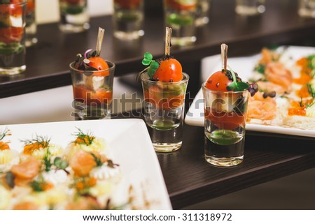 Catering for party. Close up of sandwiches, appetizers and fruit. Canapes