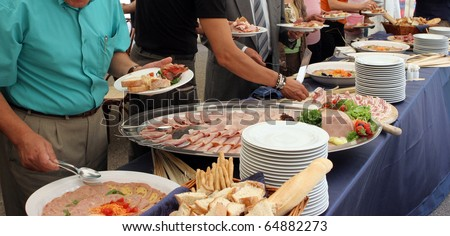 catering service, people self serving on a buffet