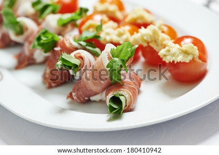 catering services background with snacks and food on plate  in restaurant
