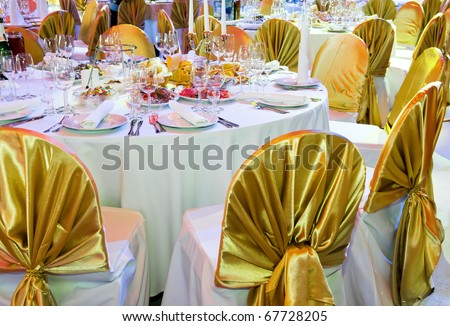 catering table set service with dish silverware and stemware glass at restaurant before party