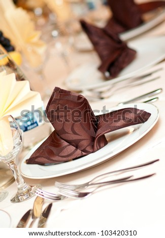catering table set service with silverware, napkin and glassware at restaurant