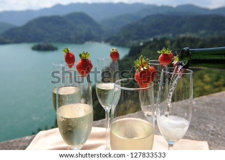 Catering, The waiter pours champagne into crystal glasses