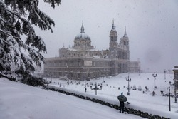 Cathedral of Almudena in madrid theater covered by snow from the storm philomena
