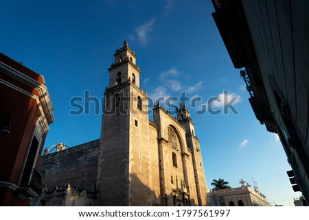 Cathedral of Merida 'San Ildefonso' surrounded by colonial buildings during scenic sunset, Merida, Yucatan, Mexico