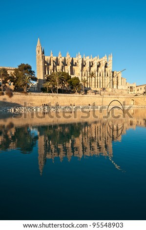 Cathedral of Palma de Mallorca and reflection on the water