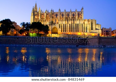 Cathedral of Palma de Mallorca La Seu night view and lake mirrored reflection - stock photo