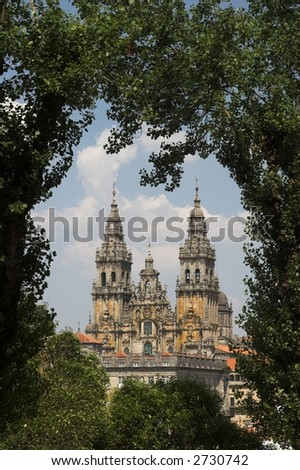 Cathedral of Santiago de Compostela seen through trees.