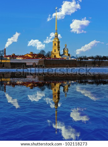 Cathedral of St. Peter and Paul Fortress and its reflection in the Neva River in St. Petersburg