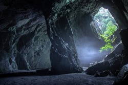 cathedral quarry, lake district national park. The chamber room also known as the cathedral. the morning mist lingering through the cave