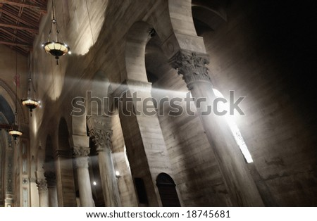 cathedral's nave with columns and light coming in from a window