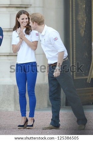 Catherine, Duchess of Cambridge and Prince Harry welcome the olympic torch to Buckingham Palace, London, UK. July 26, 2012.
