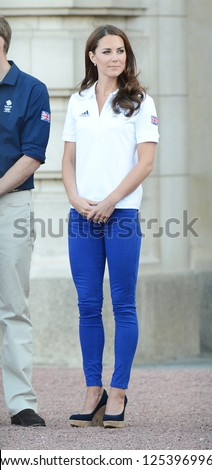 Catherine, Duchess of Cambridge welcomes the olympic torch to Buckingham Palace, London, UK. July 26, 2012.