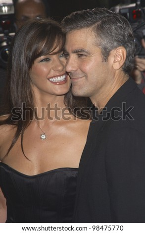 CATHERINE ZETA-JONES & GEORGE CLOONEY at the world premiere of their new movie Intolerable Cruelty, in Beverly Hills. Sept 30, 2003  Paul Smith / Featureflash