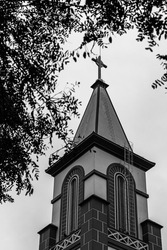 Catholic church tower in the sky black and white