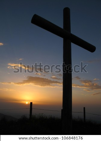 Catholic cross on the summit of a mountain