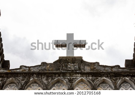 Catholic Cross On The Top Of Mang Lang Church Of Phu Yen Province, Vietnam. Mang Lang Church Is One Of The Oldest Churches In Vietnam Imbued With An Architectural Style Of The 19th Century Stock fotó ©
