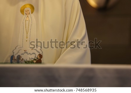 Catholic priest vestment Our lady of fatima - Shutterstock ID 748568935