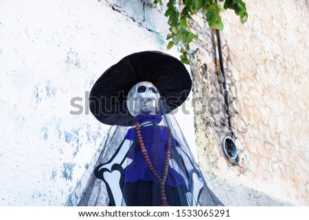 Catrina puppet at a sunny old wall as decoration for day of the dead, dia de muertos, Merida, Mexico #1533065291