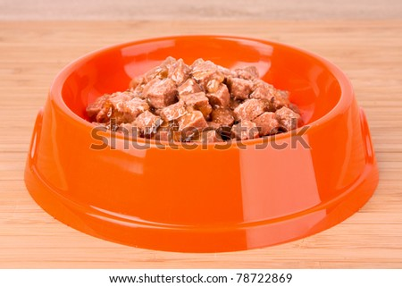 Cats food on wooden table
