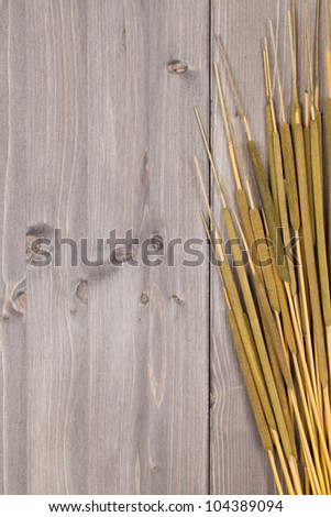 Cattail on wooden planks with copy space