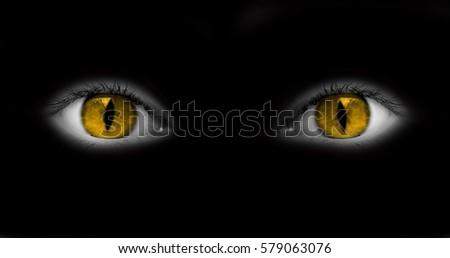 Catwoman eyes isolated on black background