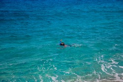 Caucasian adult male snorkeling in the Ionian Sea, near Platia Ammos Beach, in Kefalonia, Greece
