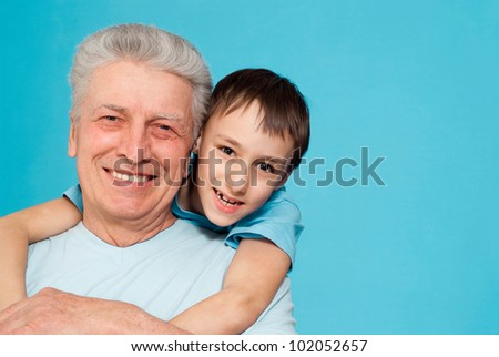 Caucasian aged male with a lad on a blue background