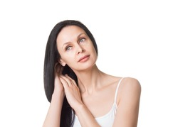 Caucasian attractive female face with long loose black hair and bare shoulders, close up. Adult woman touches her hair with hands, natural beauty, isolated on white. Skin care, moisturizing, deep