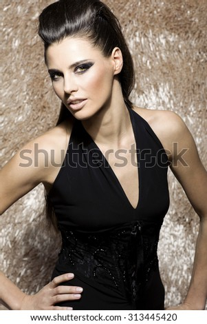Stock Photo caucasian attractive sexy fashion model with stylish hairstyle, long legs, full lips, perfect skin, wearing trendy cocktail dress, standing near shiny beige carpet, beauty photoshoot, retouched image