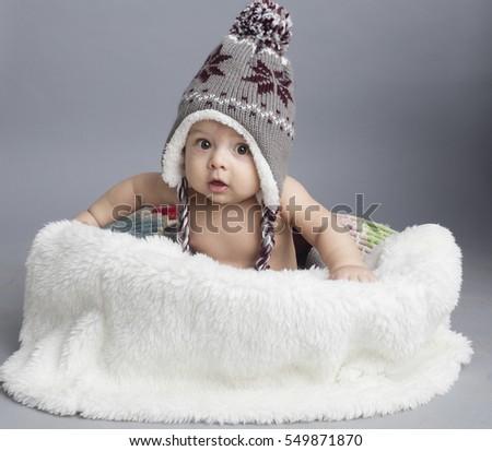 caucasian baby sitting inside...