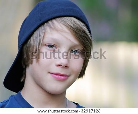 Caucasian boy wearing backwards ball cap