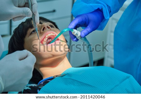 Caucasian boy with brown hair at dentist with open mouth with band breaker Photo stock ©