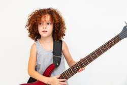 Caucasian Brazilian girl with curly hair playing guitar, double bass, musical instrument