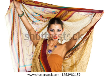 100efd7272 Caucasian brunette woman in brown indian national dress sari in studio on white  isolated background #