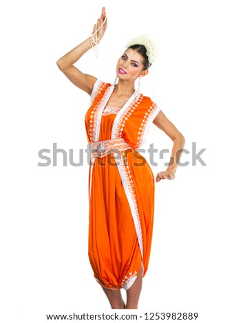 5a9397e5cb Caucasian brunette woman in orange indian national dress sari in studio on white  isolated background #