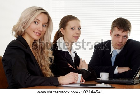 Caucasian business company of three men working at a table on a white background