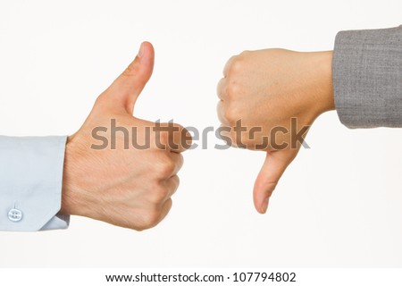 Caucasian business man and woman holding thumb up against white background