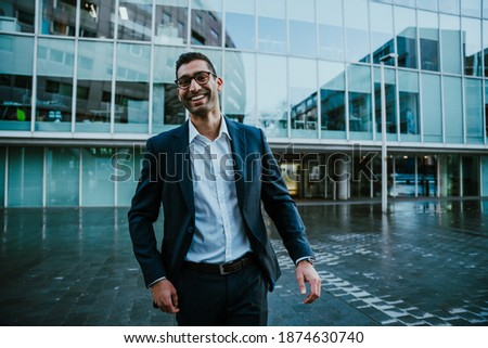 Caucasian business man wearing spectacles laughing standing outside banking office block before work shift  Foto stock ©