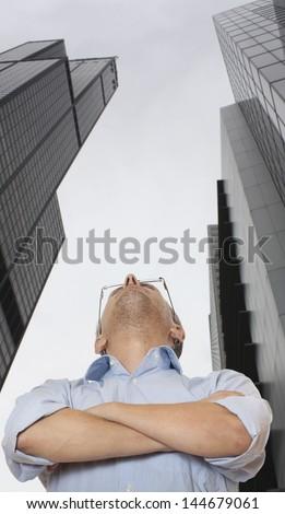 Caucasian businessman looking at a skyscraper - stock photo