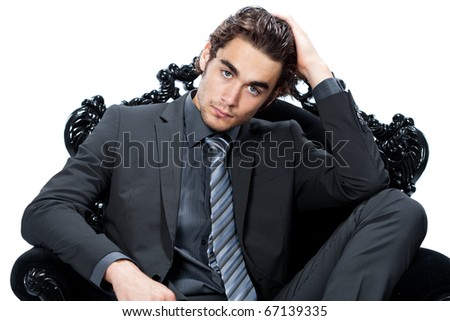 caucasian businessman on a chair