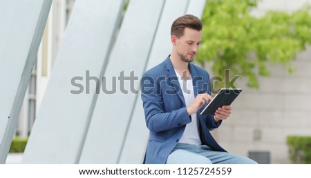 Caucasian businessman use of tablet computer